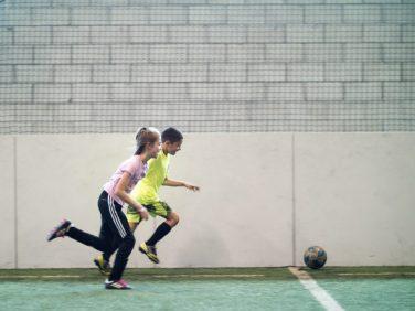 Kids playing soccer celebrating at Upland Arena