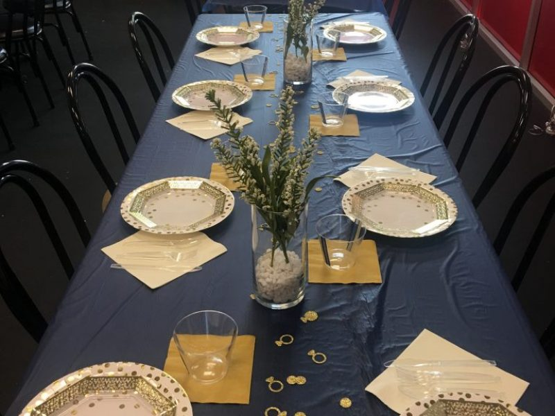 Black table with decorative paper plates